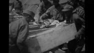 Soldiers moving boxes Stock Footage