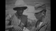Ethiopian soldier explaining to an American soldier Stock Footage
