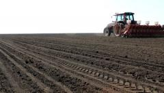 Sowing of sugar beet, the tractor in the field Stock Footage
