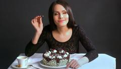 Woman eating cake. Stock Footage