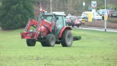 Tractor grass mower on field HD Stock Footage