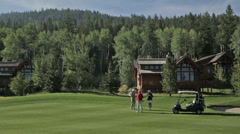 A couple golfs at an Idaho country club Stock Footage