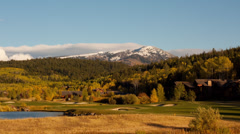 Timelapse of Idaho golf course with mountains in background Stock Footage