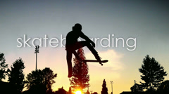 Man jumps on the skate board in slow motion Stock Footage
