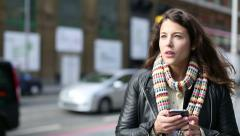 Young attractive woman standing using her mobile cell phone Stock Footage