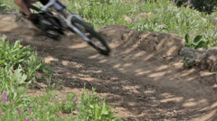 A closeup of a moutain biker rounding a corner in Idaho Stock Footage