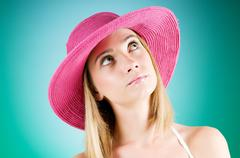 Young girl with beach hat against gradient background Stock Photos