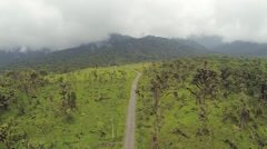 Descending over cattle pasture cut from montane rainforest  Stock Footage