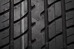 Tire isolated on black background Stock Photos