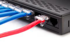 LAN network switch with ethernet cables plugged in Stock Photos