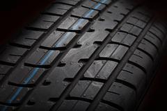 Tire isolated on black background - stock photo