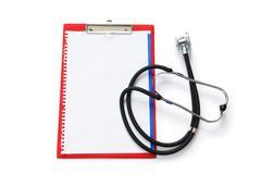 Stethoscope on the binder isolated on white Stock Photos