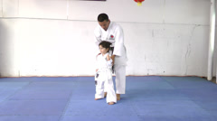 Little girl learning from her karate instructor Stock Footage