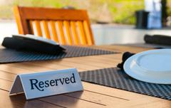 Reserved sign on a table Stock Photos