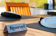Stock Photo of reserved sign on a table