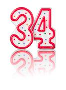 red number 34 with reflection on a white background - stock photo