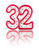 red number 32 with reflection on a white background - stock photo
