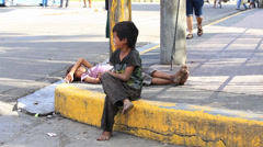 Poverty in Pholippines, a unidentified children live on the street Stock Footage