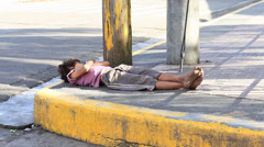 Poverty in Pholippines, a unidentified children sleeping on the street Stock Footage