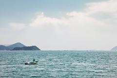 Fishmen on small boat Stock Photos