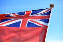 british maritime red ensign flag blue sky - stock photo