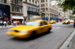 Famous New York yellow taxi cabs - intentional blur - stock photo