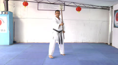 Man in karate practicing with a bo in his hands Stock Footage