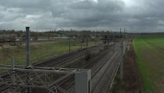 Sunlight Rays Hit the Fields and Nearby Railway Tracks Stock Footage