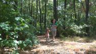 Stock Video Footage of Mother and Little Girl Running in Forest, Woman, Child in Wood, Family Lifestyle