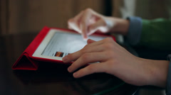 Teen boy hands using a tablet computer, browsing applications Stock Footage