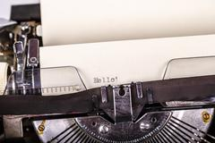 paper in typewriter with hello as a text - stock photo
