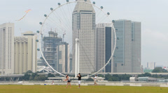 Asia Singapore Marina Bay Barrage people kite flying Stock Footage