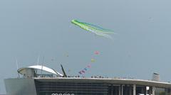 Asia Singapore Marina Bay Barrage people kite flying Stock Footage