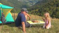 Stock Video Footage of Father and Child, Man, Girl Playing Chess on Meadow, Family Relaxing on Grass