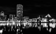Stock Photo of long exposure of the skyline at night, from the inner harbor in baltimore, ma