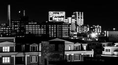 The domino sugars factory at night from federal hill, baltimore, maryland Stock Photos