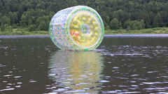 Girl in the inflatable water roller balll on the lake. Stock Footage