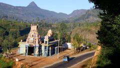 Hindu kovil in rural setting with Adam's Peak (Sri Pada) in the distance Stock Footage