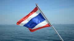 Thai flag waving on boat in ocean Stock Footage