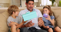 Cute children giving their father presents Stock Footage