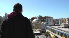A man is standing and looking at the city. Stock Footage