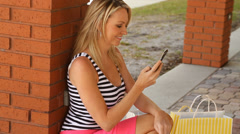 Consumer shopping woman using her mobile phone outdoors Stock Footage