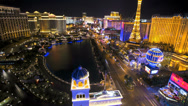 Stock Video Footage of Time lapse illuminated night Eiffel Tower traffic  Las Vegas Blvd, Nevada, USA