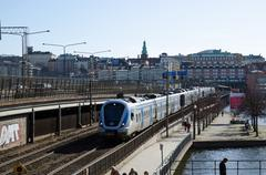 Train arriving to stockholm in sweden Stock Photos
