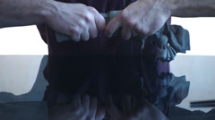 Tying a knot in the fabric,ready to paint Stock Footage