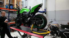 Finished working on the motorcycle - stock footage