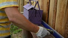 man pulls tool box materiel for wall repair nails hammer saw - stock footage