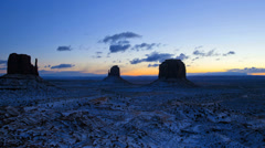 Time lapse Monument Valley dawn Mittens snow  desert Colorado Plateau, Utah, USA - stock footage