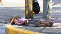 Poverty in Pholippines, a unidentified children live on the street. Stock Footage