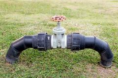 Valves for control used water in the park Stock Photos